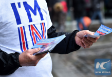 "A campaigner with Britain Stronger in Europe, the official ""Remain"" campaign for the forthcoming EU referendum, hands out leaflets in central London on April 15, 2016. (Xinhua/AFP)"