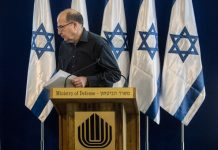 """Israel's Defense Minister Moshe Yaalon, leaves a press conference at the Defense Ministry in Tel Aviv, Israel,Friday, May 20, 2016. Israel's defense minister announced his resignation on Friday, citing a lack of """"trust"""" in Prime Minister Benjamin Netanyahu after reports in recent days that Netanyahu intends to appoint former foreign minister Avigdor Lieberman to the post. (AP Photo/Sebastian Scheiner)"""