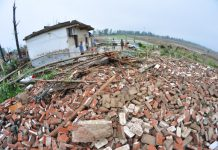 Villagers survey the rubble of a collapsed house after a tornado struck Funing in Jiangsu province on Thursday. [Photo/China Daily]