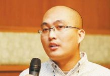 Jin Bo, the 34-year-old vice editor-in-chief at Tianya Club, passed out and died soon after at a metro station in Beijing on June 29. [File photo]