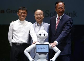 "Jack Ma (L), Chairman of the Board of Alibaba Group, Softbank's president Masayoshi Son, and Terry Gou (R), founder and chairman of Foxconn, pose for photo with a humanoid robot ""Pepper"" during the Softbank's press conference in Chiba, Japan, June 18, 2015. [Photo/Xinhua]"