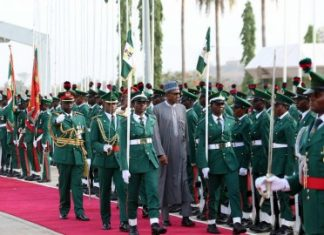 File Photo: President Muhammadu Buhari inspecting the Guards of honour.