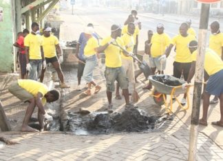 Vivo Energy Ghana Staff and Community Members cleaning their community
