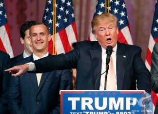 This file photo taken on March 15, 2016 shows Republican presidential candidate Donald Trump with his campaign manager Corey Lewandowski(L) addressing the media following victory in the Florida state primary in West Palm Beach, Florida. [Photo/Xinhua]
