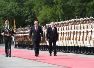 Chinese President Xi Jinping (L on the red carpet) holds a welcoming ceremony for Russian President Vladimir Putin (R) before their talks at the Great Hall of the People in Beijing, capital of China, June 25, 2016. [Photo/Xinhua]