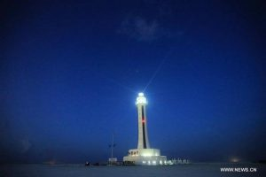 Photo taken on April 5, 2016 shows the lighthouse on Zhubi Reef of Nansha Islands in theSouth China Sea, south China. (Xinhua file photo)