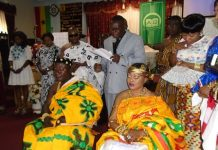 Reverend Atuahene blessing the harvest king and queen
