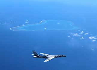 """Undated photo shows a Chinese H-6K bomber patrolling islands and reefs including Huangyan Dao in the South China Sea. The People's Liberation Army (PLA) Air Force conducted a combat air patrol in the South China Sea recently, which will become a """"regular"""" practice in the future, said a military spokesperson on July 18, 2016. The PLA sent H-6K bombers and other aircraft including fighters, scouts and tankers to patrol islands and reefs including Huangyan Dao, said Shen Jinke, spokesman for the PLA Air Force. (Xinhua/Liu Rui)"""