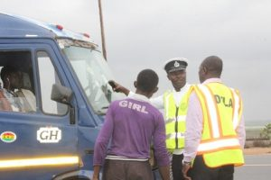police  and  DVLA  officials   checking  some  vehicles  on  Nungua  Tema  road.