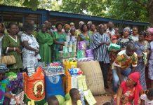 Mr Sepaga Richard, Chairman of the Kassena/Nankana Association of Ola Cathedral Church in Tamale presenting the items