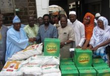 Alhaji Abdul Salam, Protocol Officer receiving the items on behalf of the National Chief Imam from Dr Vanderpuije.