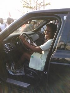EXCITED EUGENIA, IN THE DRIVER'S SEAT OF HER NEW RANGE ROVER