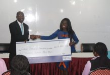 GJA President receiving a dummy cheque from Gifty Bingley on behalf of the Association,