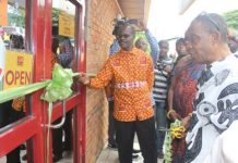 Dr Nduom being assisted by Togbe Gobo Dake XII to officially open the Bank.