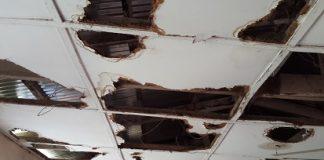 A kindergarten classroom with a decrepit ceiling.