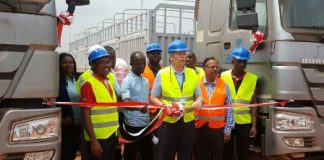 Mr Nygard (Middle) MD of Dangote cutting the ribbon at Tema