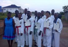 Some of the participants displaying their certificates and belts
