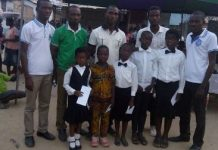 Mr Atukpa in the middle in a group photograph with the participants and the winners.