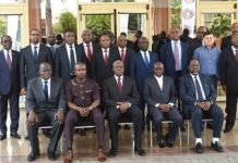 Vice President Amissah-Arthur in a group photograph with Executives of APUA.