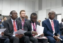 Ambassador Alabo, Front Row, On Extreme Right