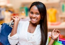 Beautiful shopping woman smiling and holding bags; Shutterstock ID 150260165; PO: aol; Job: production; Client: drone