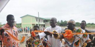 Vice President Amissah-Arthur being assisted by Daasebre Kwebu Ewusi VII to inaugurate the Abeadze State College building at Abeadze Dominase.