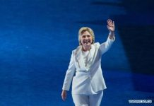 "U.S. Democratic Presidential Candidate Hillary Clinton gestures to spectators on the last day of the 2016 U.S. Democratic National Convention at Wells Fargo Center, Philadelphia, Pennsylvania, the United States, on July 28, 2016. Former U.S. Secretary of State Hillary Clinton has formally accepted the U.S. Democratic Party' s nomination for president and pledged more economic opportunities for Americans and ""steady leadership"". (Xinhua/Li Muzi)"