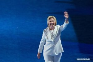 """U.S. Democratic Presidential Candidate Hillary Clinton gestures to spectators on the last day of the 2016 U.S. Democratic National Convention at Wells Fargo Center, Philadelphia, Pennsylvania, the United States, on July 28, 2016. Former U.S. Secretary of State Hillary Clinton has formally accepted the U.S. Democratic Party' s nomination for president and pledged more economic opportunities for Americans and """"steady leadership"""". (Xinhua/Li Muzi)"""
