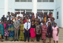 The participants in a group picture with Air Vice Marshal Griffiths Santrofi Evans, and Mr Andrew Barnes
