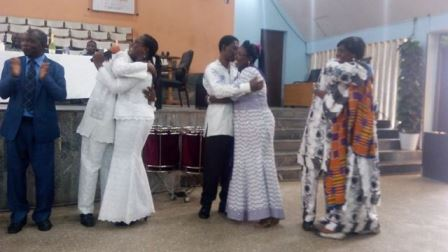 Some couples at the cake cutting ceremony marking the Family Impact Ghana 20th anniversary celebration