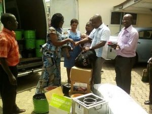 Mrs Agbey presenting the items to Mr Asare