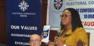 Mrs Charlotte Osei (right) launching the document with Mr Robert P. Jackson looking on