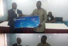 Dr Affail Money receiving the cash.