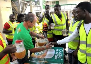 Retailers tasting fresh beer from the storage tanks