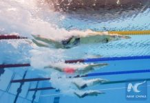 A picture taken with an underwater camera shows Australia's Mack Horton (L) and China's Sun Yang (C) compete in the Men's 400m Individual Medley Final during the swimming event at the Rio 2016 Olympic Games at the Olympic Aquatics Stadium in Rio de Janeiro on August 6, 2016. (Xinhua)