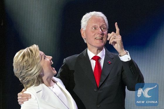 U.S. Democratic Presidential Candidate Hillary Clinton (L) and her husband former U.S. President Bill Clinton take the stage at the end of the 2016 U.S. Democratic National Convention at Wells Fargo Center, Philadelphia, Pennsylvania, the United States on July 28, 2016. [Photo/Xinhua]