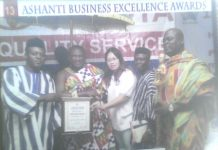CEO of Aboboyaa Company ltd, Mr. Gideon Seidu, first from left, receiving his award.