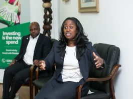 Lynn Dadzie-Yeboah (right) giving a speech with her is CEO Databank