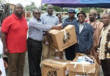 Mr Sam Atukwi Quaye (second left) receiving the items from Rev Moses Allison Tetteh. On the extreme left Mr Emmanuel Nii Okai Laryea and extreme right Nii Kortey Boi II, Ofankor Mantse