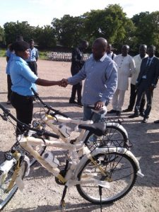 Mr Beecham presenting the bicycle to one of the recruits