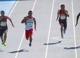 2016 Rio Olympics - Athletics - Preliminary - Men's 100m Preliminary Round - Olympic Stadium - Rio de Janeiro, Brazil - 13/08/2016. Riste Pandev (MKD) of Macedonia, Sudirman Hadi (INA) of Indonesia, Abdul Wahab Zahiri (AFG) of Afghanistan and Wilfried Bingangoye (GAB) of Gabon compete. REUTERS/David Gray FOR EDITORIAL USE ONLY. NOT FOR SALE FOR MARKETING OR ADVERTISING CAMPAIGNS.