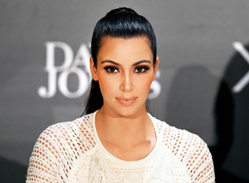 Kim Kardashian Settles Paris Robbery Libel Lawsuit against Media Take Out