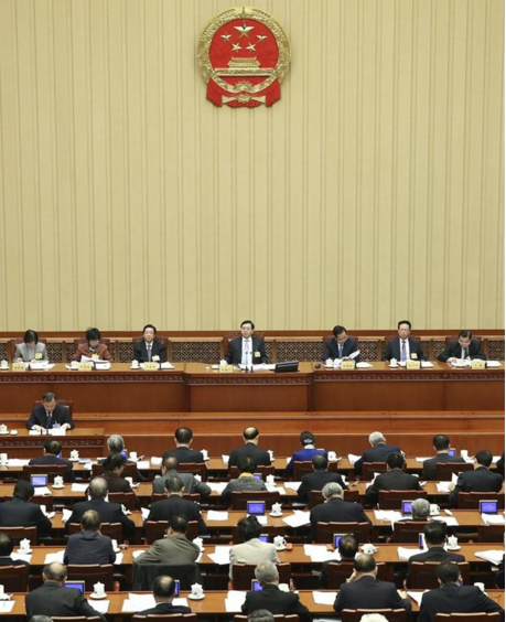 China bars 2 Hong Kong lawmakers from office in unprecedented act