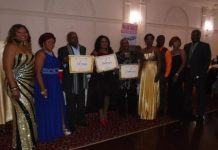 Mr. Emilianus Mafie and others receiving their prize.