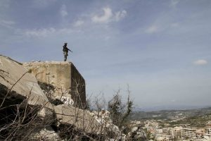 A Syrian soldier guards a highland at Salma Town in Lattakia, Syria, March 19, 2016. (Xinhua/Yang Zhen) (zw)