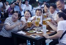 People drink beer during the Pyongyang Taedonggang Beer Festival in Pyongyang, capital of the Democratic People's Republic of Korea (DPRK), Aug. 12, 2016. (Xinhua/Lu Rui) (zw)