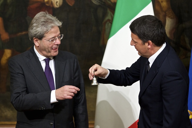 Former Italian Prime Minister Matteo Renzi (R) hands over the cabinet minister bell to Italy's newly-appointed Prime Minister Paolo Gentiloni at the handover ceremony at Chigi Palace in Rome, capital of Italy, on Dec. 12, 2016. (Xinhua/Jin Yu) (zw)