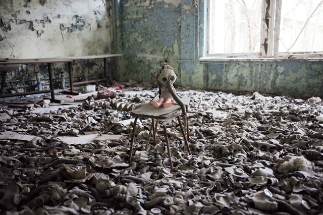 Photo taken on April 19, 2016 shows a doll with a gas mask in a deserted school in Pripyat city near Chernobyl, Ukraine. (Xinhua/Dai Tianfang) (zw)