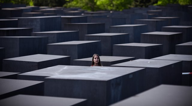 A girl visits the Memorial to the Murdered Jews of Europe in Berlin, Germany, on May 8, 2016. (Xinhua/Zhang Fan) (zw)