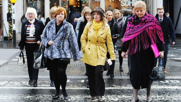 Relatives return after lunch at the Royal Courts of Justice in London, for the inquest into the deaths of 30 Britons in the Tunisia beach terror attack